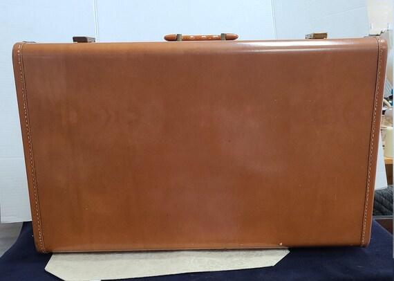 Leather Maximillian suitcase