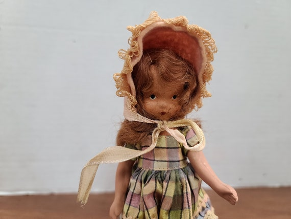 "Nancy Ann storybook doll brown hair 5""bisque 1940's in original outfit."