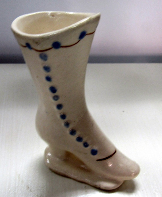White ceramic miniature shoe