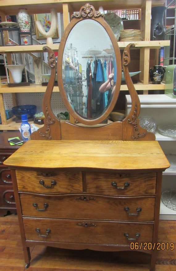 Oak dresser with oval mirror