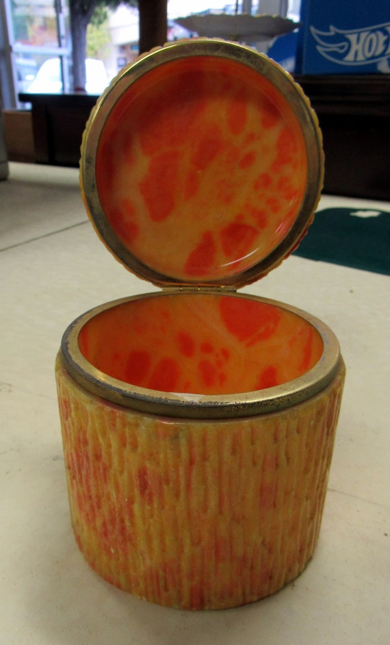 Orange container with hinged lid