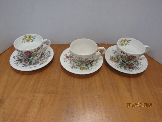 3 May Flower cups and saucers