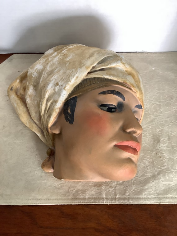 Bust of stoic woman