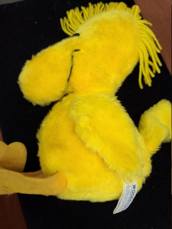 """Knickerbocker  Woodstock 10 1/2"""" plush toy."""