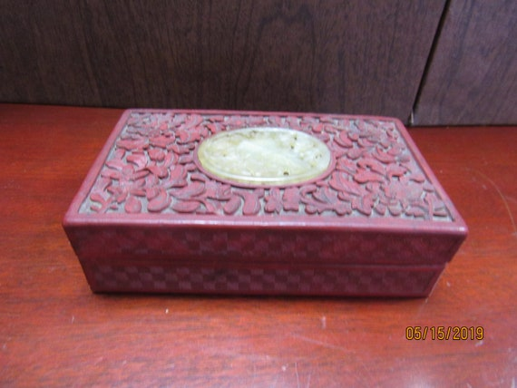 Red laquer trinket box with jade insert