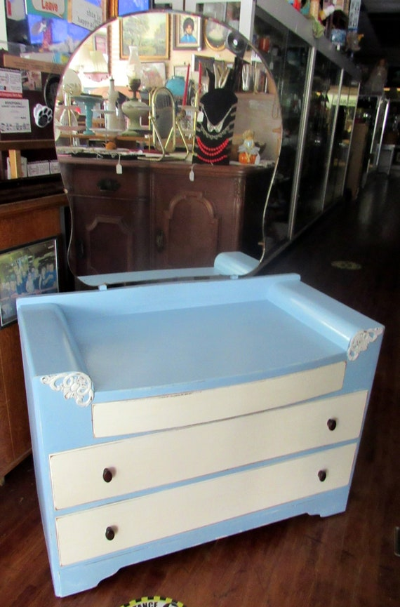 Blue and white dresser with mirror