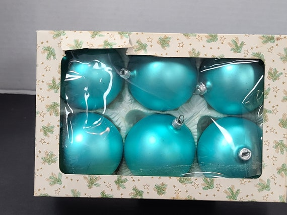 Teal glass Christmas ornaments in box