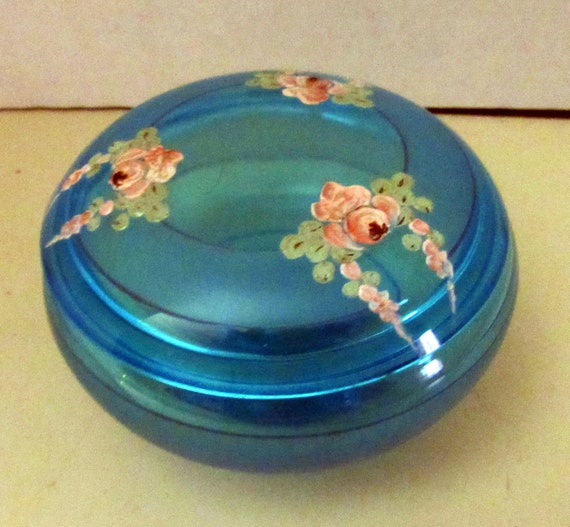 Aqua glass lidded jar with hand painted floral design
