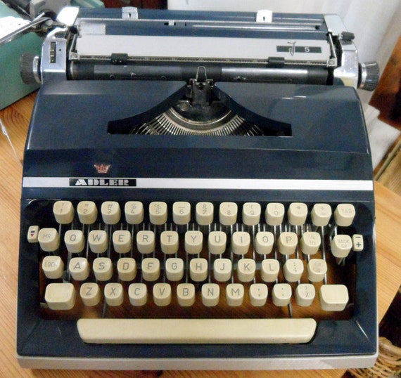 Adler Portable Typewriter Blue with new ribbon works great