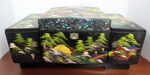 Asian black lacquer musical jewelry box with key