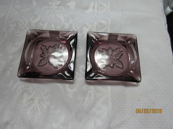 Pair of purple ashtrays