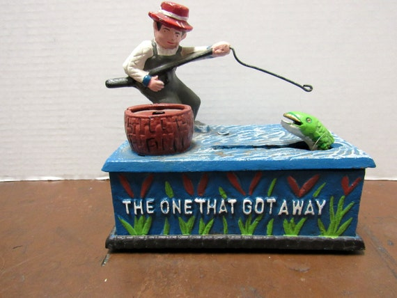 Cast Iron Bank with fisherman