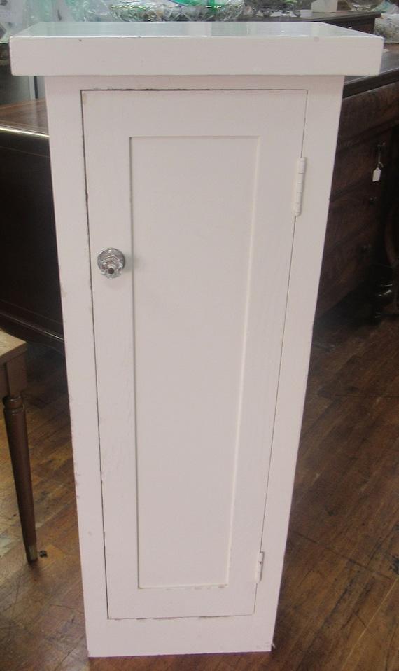 Narrow white cabinet