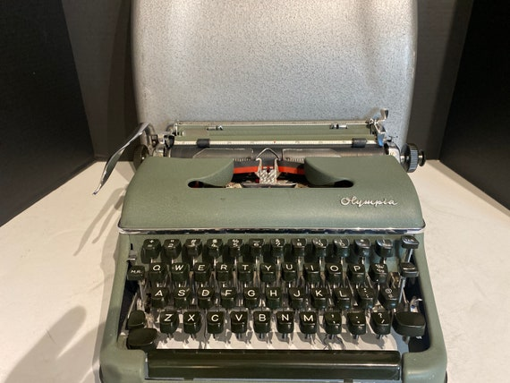 Olympia Deluxe Green and Chrome Portable Typewriter