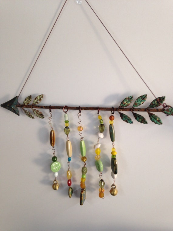 Arrow wall art or sun catcher.