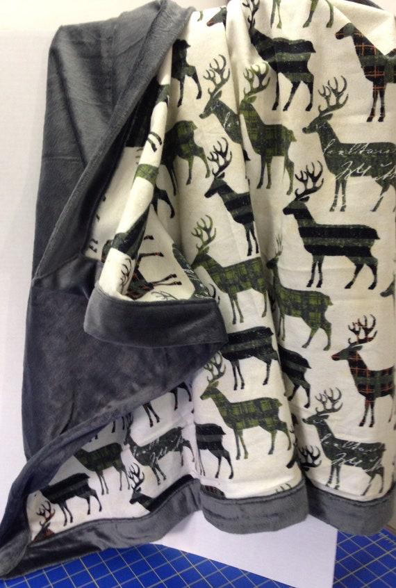 Montana inspired baby blanket . Plaid deer in green and black