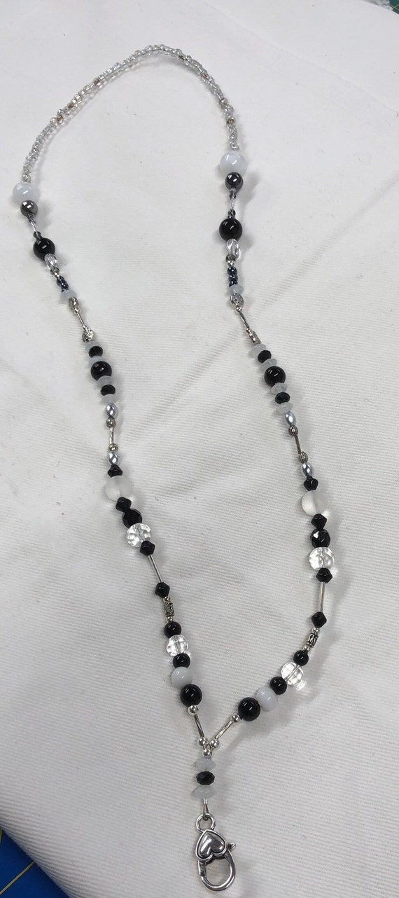 Lanyard in black White and clear beads perfect for keys or badge holder.