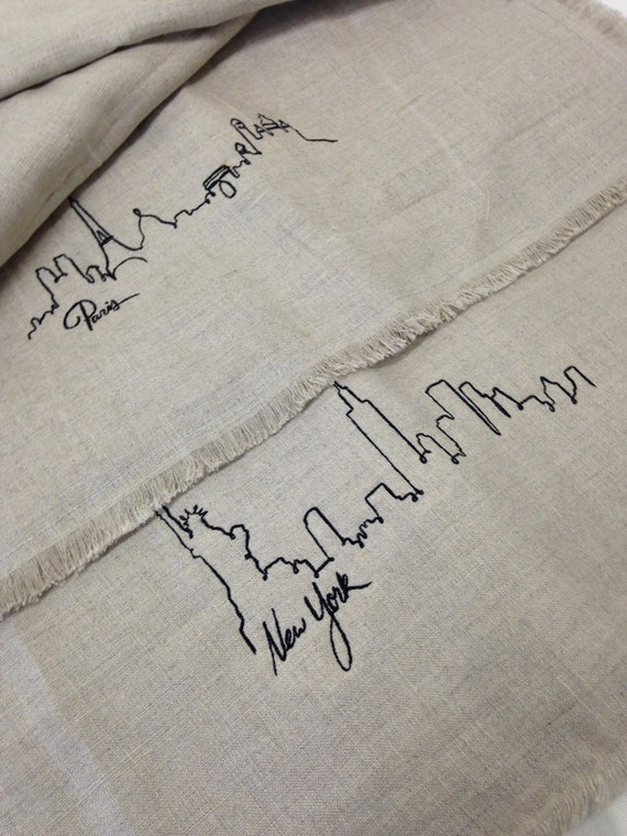 Linen napkins embroidered with Paris and New York City scapes