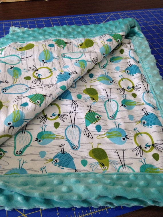Baby blanket with minky on one side and flannel blue and cute birds