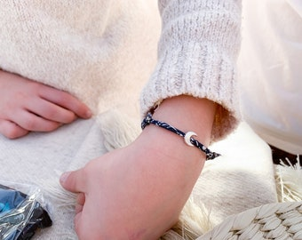 Bracelet with a Sterling silver half moon and Liberty cotton cord.
