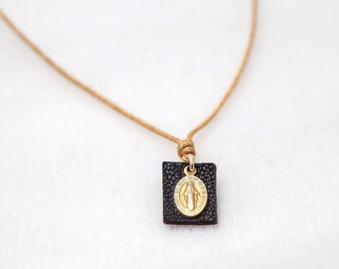 Tiny Miraculous Lady medal necklace.