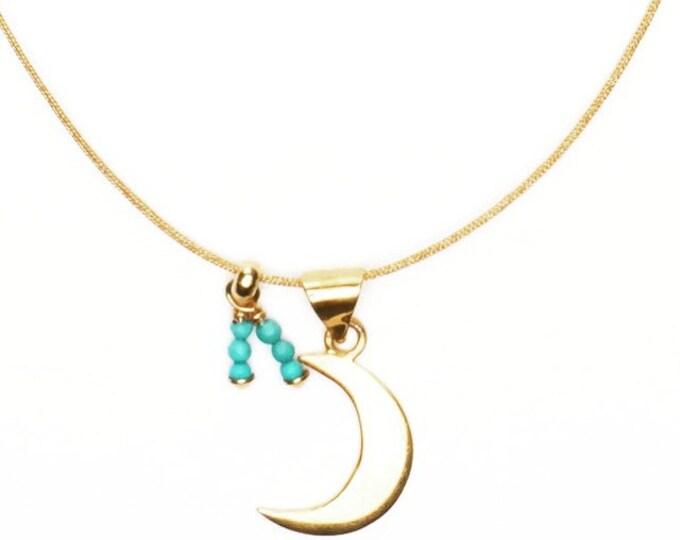 Collar BLUE MOON/ Plata chapada en oro/ Pequeñas turquesas/Cordón.