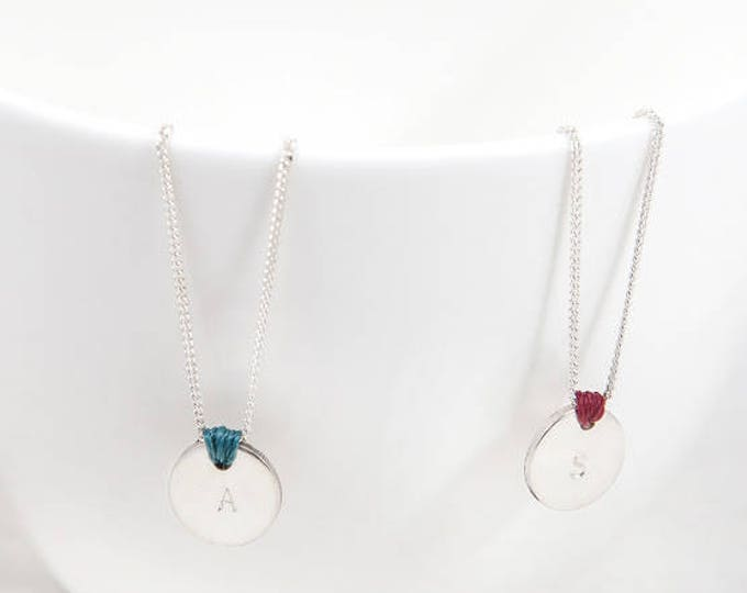 SEI necklace/Sterling silver disc and chain..