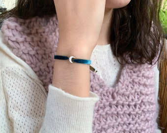Sterling silver half moon bracelet/stretch velvet cord.