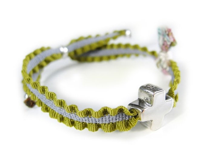 Mini Cross Bracelet/stretch cord/ small fabric tassel.
