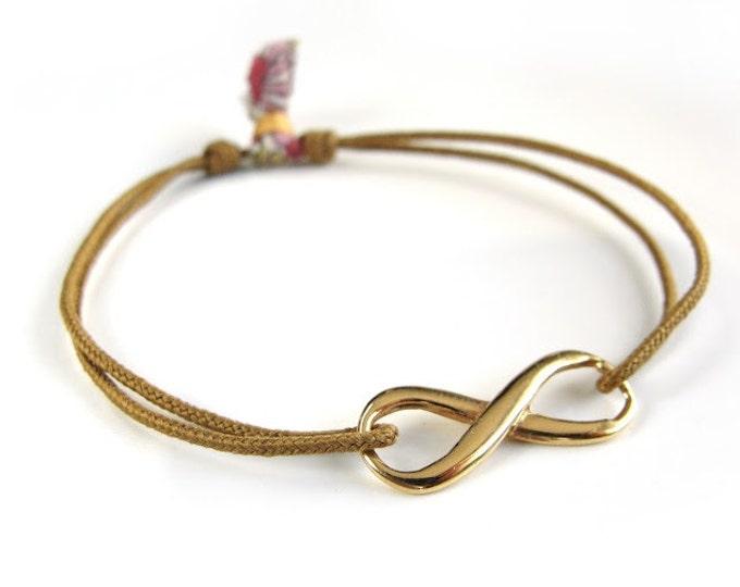 Pulsera INFINITO/ Plata chapada oro/ Cordón