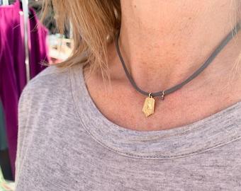 18k gold Scapular necklace/stretch cord/semiprecious stone.