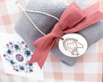 Sterling silver medallion for crib/cotton ribbon.