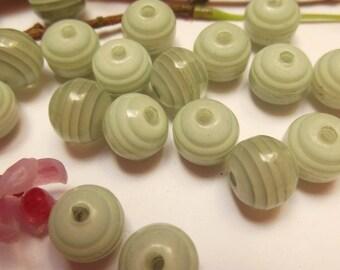 set of 18 green plastic beads