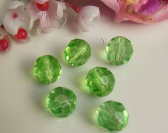 set of 12 pearls has green 10mm Czech glass faceted
