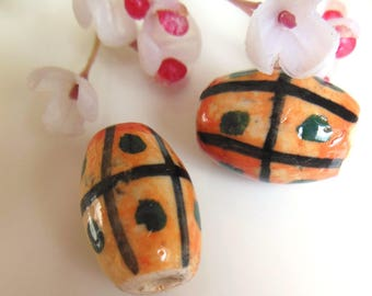 set of 2 olive green and orange ceramic beads