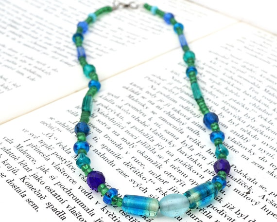 Vintage beaded necklace from the 1980s with a blue flower