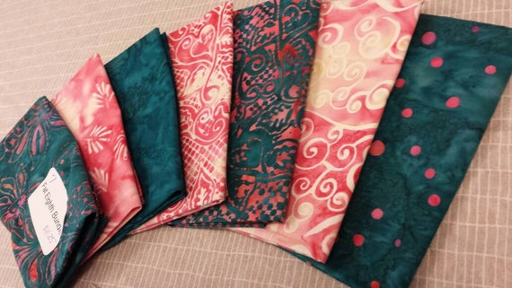 Batik Quilt Fabric Bundle of 7 Fat Eighths In Pink and White and Deep Teal Island Themed Floral Designs With Dots and Swirls and Leaves
