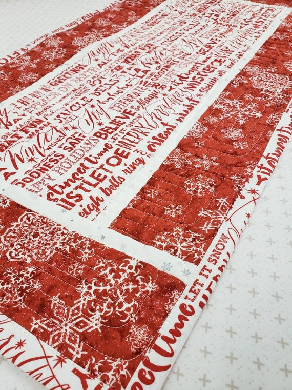 "Christmas Holiday Table Topper In Red, White and Grey 14"" x 26"",  Words On Fabric And Snowflakes on Red Borders, Red and White"