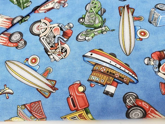 Where The Toys Are, Planes Trains and Automobiles On Blue Dan Morris for RJR fabric by the yard 1708 002