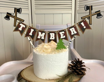 """Timber! Lumberjack Cake Topper w/ axes & tree picks! Muted buffalo plaid pennants and """"birch tree"""" straws. Customize up to 7 letters!"""