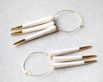 Amazone, porcelain and gold earrings, glazed .Porcelain jewelry