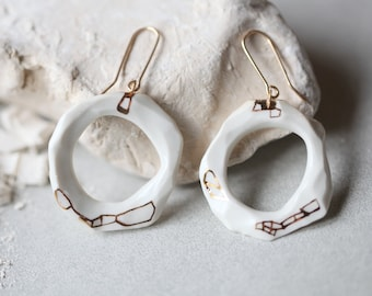 Ikopa , porcelain and gold earrings, glazed .Porcelain jewelry