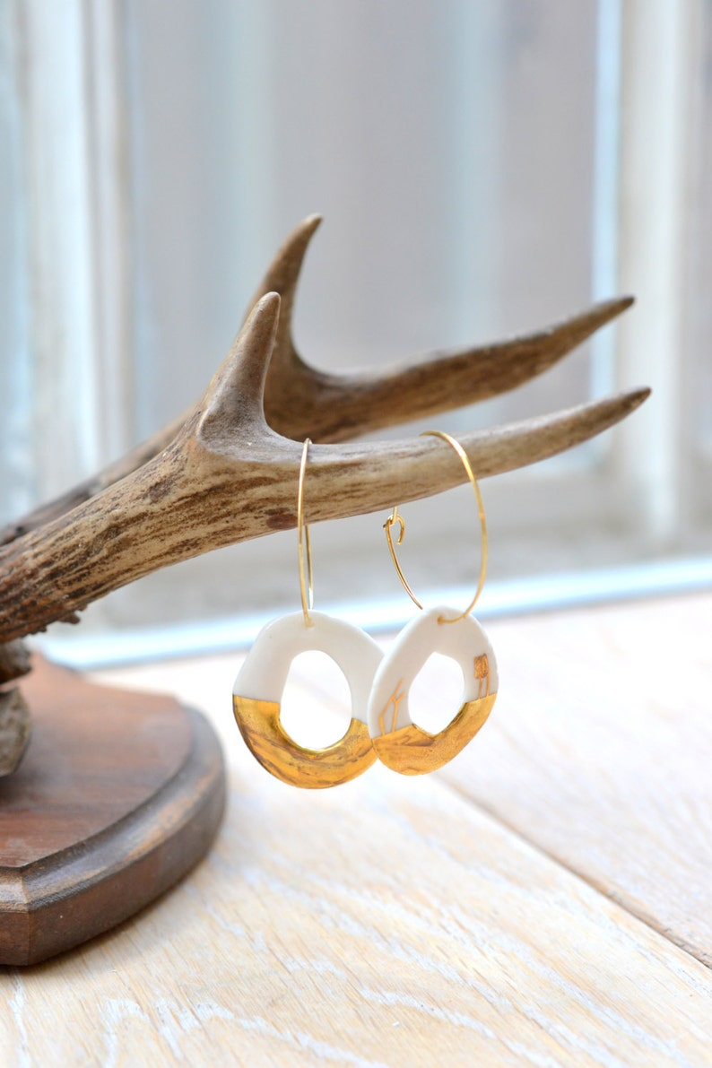 glazed .Porcelain jewelry porcelain and gold earrings Emba