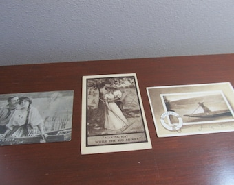 """Antique post cards; young lovers in boat """"On the River""""; """"Making Hay While the Sun Shines"""", """"All Good Wishes""""; 1907 and 1910 x 2; collection"""