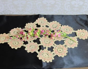 Crocheted doily; entwined pink ribbon; early 1900's; ecru and pale pink; awesome!