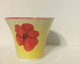 Yellow vase with red flowers