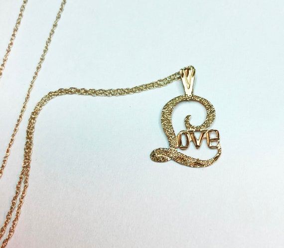 """14K Love Necklace the word love on 14K 18"""" chain"""