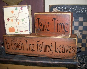 Primitive Block Sign Take time to catch the falling leaves