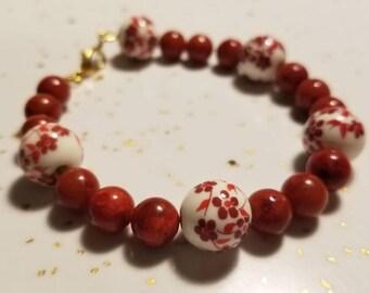 Red jasper and ceramic beaded bracelet