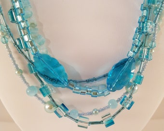 Aqua beaded necklace and earring set